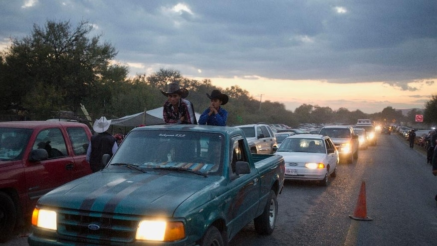 Heavy traffic blocks a road as visitors try to get to a party honoring Rubi Ibarrafor her down-home 15th birthday near the village of Laguna Seca, San Luis Potosi State, Mexico, Monday Dec. 26, 2016. Rubi's 15th birthday party resembled a rock concert on Monday after thousands of people showed up in response to an invitation by her father that went viral and made her the toast of the country. (AP Photo/Enric Marti)