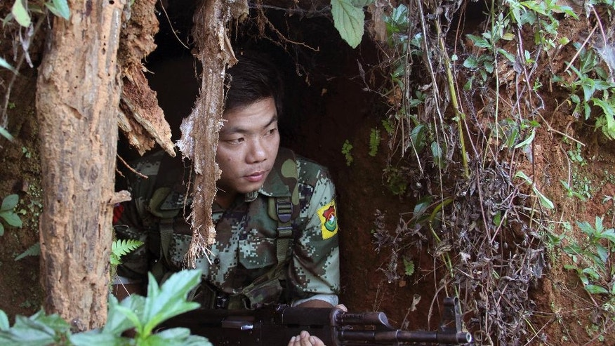 In this Nov. 30, 2016 photo, a Kachin Independence Army (KIA) soldier sits inside the bomb shelter along the bunker at the front line of Alen Bum near Laiza, the headquarters of KIA in Kachin State, Myanmar.  Ethnic Kachin rebels long at war with Myanmar troops say the government has only escalated fighting since Aung San Suu Kyi took over as leader, crushing the hopes that had led many ethnic minorities to support her party and leaving them with no confidence in the peace process that Suu Kyi has identified as a priority.(AP Photo/Esther Htusan)