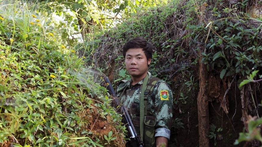 In this Nov. 30, 2016 photo, a Kachin Independence Army (KIA) soldier patrols at the front line through the bunkers of Alen Bum near Laiza, the headquarters of the KIA in Kachin State, Myanmar.  Ethnic Kachin rebels long at war with Myanmar troops say the government has only escalated fighting since Aung San Suu Kyi took over as leader, crushing the hopes that had led many ethnic minorities to support her party and leaving them with no confidence in the peace process that Suu Kyi has identified as a priority. (AP Photo/Esther Htusan)