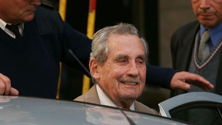 FILE - In this Nov. 5, 2007 file photo, former Uruguayan dictator Gregorio Alvarez arrives to court in Montevideo, Uruguay. Alvarez, the last de facto president of the dictatorship that ruled Uruguay between 1973 and 1985, died on Wednesday, Dec. 28, 2016. He was 91. (AP Photo/Alejandro Arigon, File)