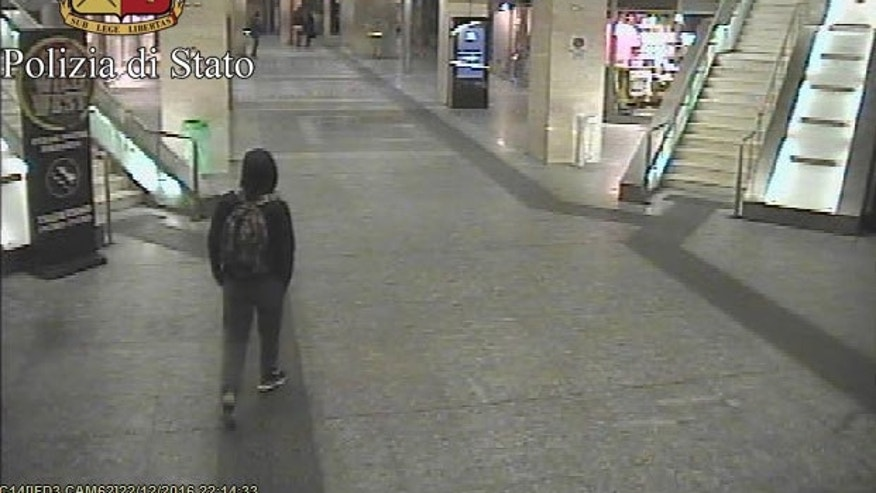 In this frame grab made available by the Italian police, Anis Amri, the main suspect in Berlin's deadly Christmas market attack walks through the train station on Dec. 22.  (Italian Police via AP)
