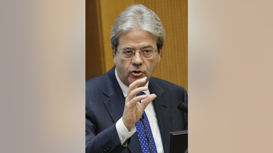Italian Premier Paolo Gentiloni answers to journalists' questions as he holds a year-end press conference, in Rome, Thursday Dec. 29, 2016. Gentiloni said the government will take further measures to combat terrorism following the shooting death of a Tunisian fugitive near Milan, including speedier repatriation of illegal migrants. (Giuseppe Lami/ANSA via AP)