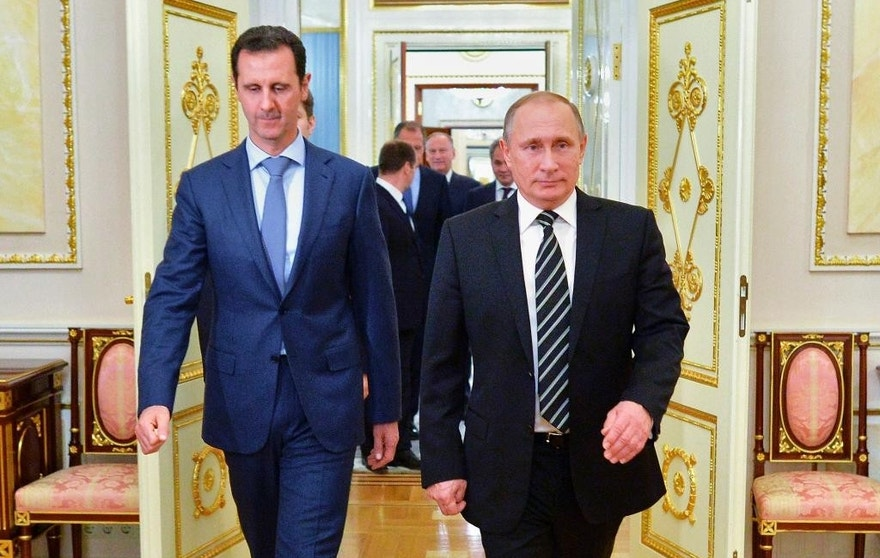 FILE -- In this Oct. 20, 2015 file photo, Russian President Vladimir Putin, right, and Syria President Bashar Assad arrive for their meeting in the Kremlin in Moscow, Russia. With his victory in Aleppo, Assad appears to have survived a nearly six-year war to drive him from power, but he is now more dependent on outside powers than ever. His key allies Russia and Iran, along with Turkey, are best placed to determine Syria's endgame, which could more closely resemble a grand bargain among great powers than a political settlement among Syrians themselves. (Alexei Druzhinin, RIA-Novosti, Kremlin Pool Photo via AP, File)