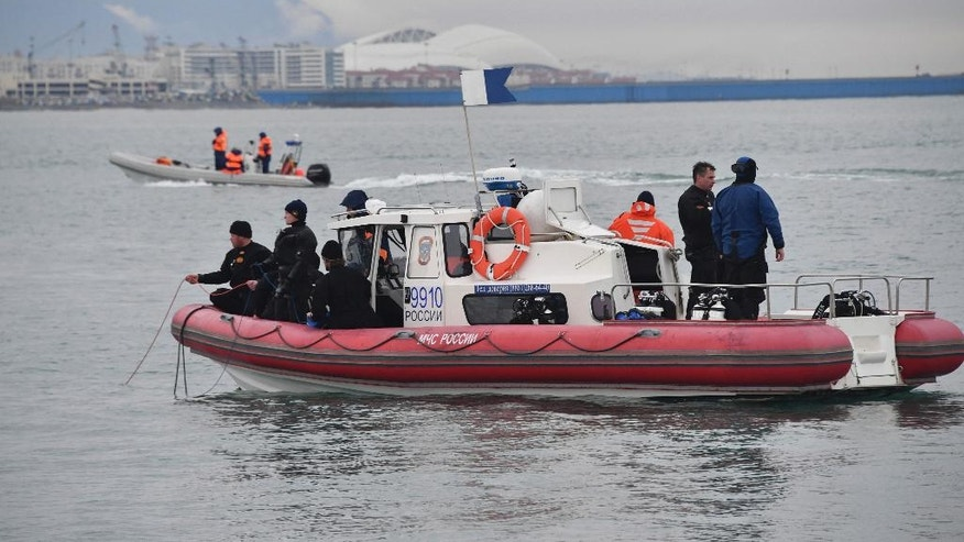 In this photo taken on Wednesday, Dec. 28, 2016 photo provided by the Russian Emergency Ministry Press Service, ministry employees on boats search for fragments of a plane in the Black Sea, outside Sochi, Russia. Russia's Defense Ministry says search teams have recovered another flight recorder from a military plane that crashed in the Black Sea, killing all 92 aboard. (Vladimir Velengurin/Emergency Situations Ministry Photo via AP)