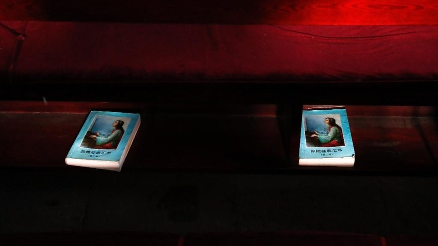 "In this Wednesday, Dec. 28, 2016 photo, sunlight is cast on copies of the Mass praying song bible as they are placed underneath the seat at Nantang Catholic Church in Beijing. One of China's top leaders told Chinese Catholics that they need to operate ""independently"" of outside forces and promote socialism and patriotism through religion. (AP Photo/Andy Wong)"