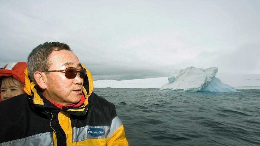In this Nov. 9, 2007 photo provided by the United Nations, U.N. Secretary-General Ban Ki-moon looks out over the waters off King George Island, Antarctica. Passionate about the environment, Ban worked to raise climate change close to the top of the global agenda. (Eskinder Debebe/The United Nations via AP)