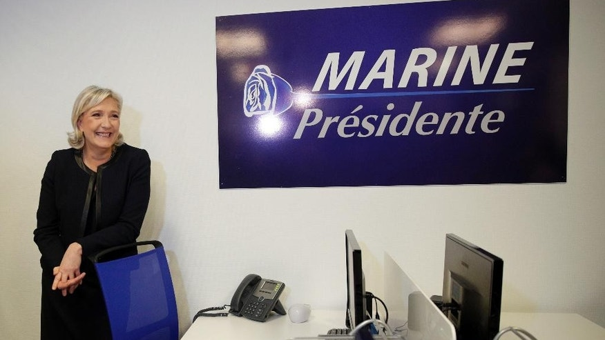FILE - This is a Wednesday, Nov. 16, 2016  file photo of far-right leader Marine le Pen posing as she inaugurates her campaign headquarters, in Paris.  Europe's leaders are not expecting a smooth ride in 2017 following a year marked by political upheaval, terror attacks, unchecked immigration, and a rising military threat from Russia.  Britain is suing for divorce, the far-right is on the march, some former Soviet satellites are backsliding even as Russia seeks to expand its influence.  (AP Photo/Christophe Ena, File)