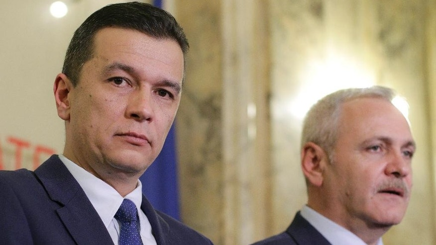 In this photo dated Wednesday Dec. 28, 2016, Sorin Grindeanu, left, Romania's Prime Minister designate stands next to Liviu Dragnea, the leader of the Social Democrat party, during a press conference in Bucharest, Romania. Romania's president nominated regional politician, Sorin Grindeanu, 43, as the next prime minister, after turning down an economist, Sevil Shhaideh, who could have become the country's first female Muslim premier. (AP Photo/Octav Ganea)