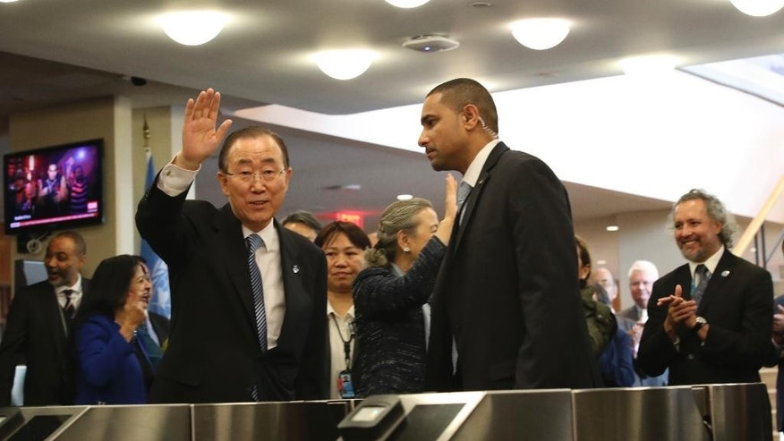 United Nations Secretary-General Ban Ki-moon waves to his staff on his last day at the U.N. headquarters, Friday, Dec. 30, 2016. (AP Photo/Mary Altaffer)