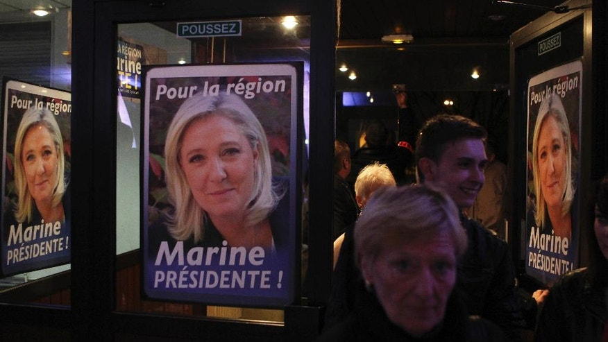 "FILE - In this Nov. 6, 2015 file photo, supporters arrive before a meeting with the French far-right National Front party leader Marine Le Pen in Wattrelos, northern France. Money, and how to get it, has dogged French far-right presidential contender Marine Le Pen for years. Now, as her National Front party's treasurer says it's looking ""everywhere"" for the 20 million euros ($21 million) needed to fund upcoming campaigns, she may be looking to Russia for cash  again. . (AP Photo/Michel Spingler, File)"