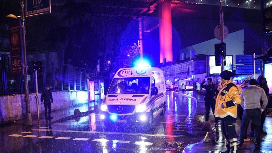 Ambulances rushing away from the scene of an attack in Istanbul, early Sunday, Jan. 1, 2017. Private NTV television said more than one assailant may have been involved in the attack. The attacker or attackers are believed to have entered the nightclub in Istanbul's Ortakoy district disguised as Santa Claus, the station reported. (AP Photo)