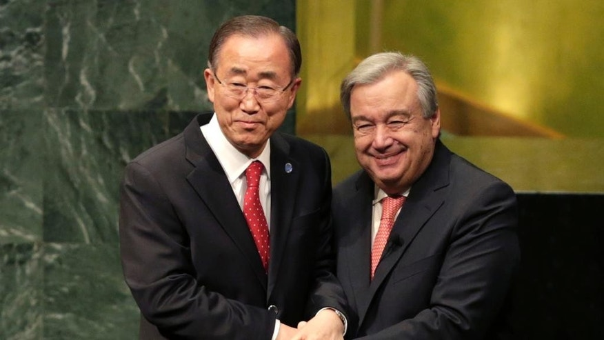 "FILE - In this Dec. 12, 2016 file photo, United Nations Secretary-General Ban Ki-moon, left, clasps hands with U.N. Secretary-General designate Antonio Guterres after Guterres was sworn in at U.N. headquarters. Guterres takes the reins of the United Nations on New Year's Day, promising to be a ""bridge-builder"" but facing an antagonistic incoming U.S. administration led by Donald Trump who thinks the world body's 193 member states do nothing except talk and have a good time. (AP Photo/Seth Wenig, File)"