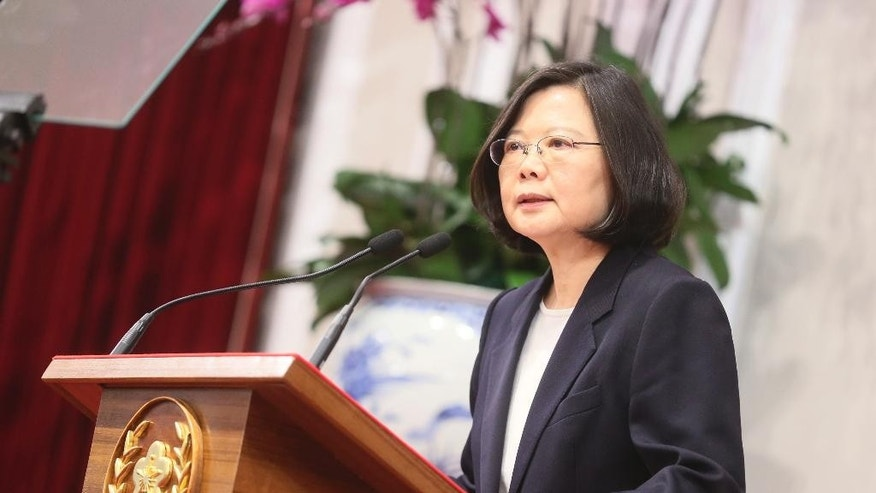 "In this photo released by the Taiwan Presidential Office, President Tsai Ing-wen delivers a year-end speech during an international press conference at the presidential office, Saturday, Dec. 31, 2016, in Taipei, Taiwan. President Tsai urged China to engage in ""calm and rational"" dialogue to maintain peace, vowing not to give in to Beijing's recent moves to ""threaten and intimidate"" the self-ruled island. (Taiwan Presidential Office via AP)"