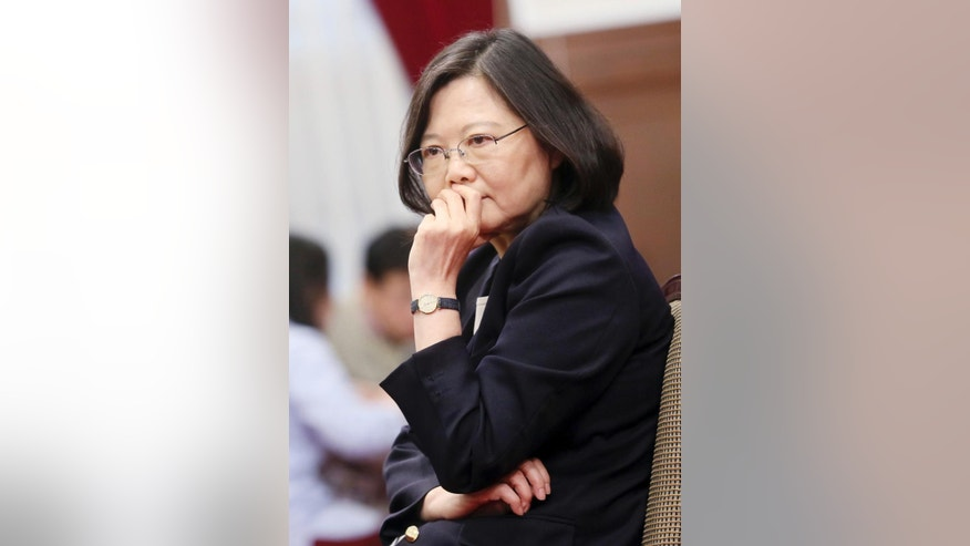 "In this photo released by the Taiwan Presidential Office, President Tsai Ing-wen pauses during an international press conference at the presidential office, Saturday, Dec. 31, 2016, in Taipei, Taiwan.  President Tsai urged China to engage in ""calm and rational"" dialogue to maintain peace, vowing not to give in to Beijing's recent moves to ""threaten and intimidate"" the self-ruled island. (Taiwan Presidential Office via AP)"