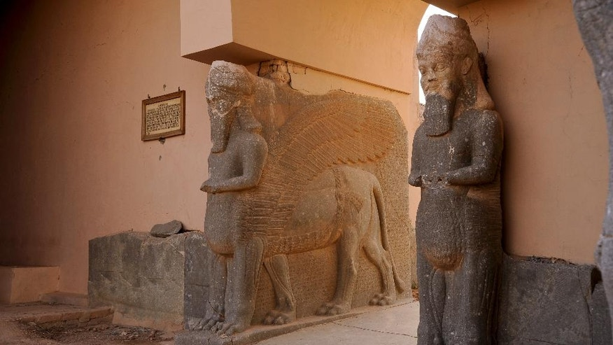 This Nov. 19, 2008 photo released by the U.S. Army shows the statues of the lamassu, the winged, human-headed bulls that stood at the gates of the palace and were believed to ward off evil in the ancient city of Nimrud, near Mosul, Iraq. The bulls were destroyed by Islamic State group militants in early 2015 as they razed the entire site, one of the most important archaeological ruins in the Middle East. (Staff Sgt. JoAnn S. Makinano, U.S. Army via AP)
