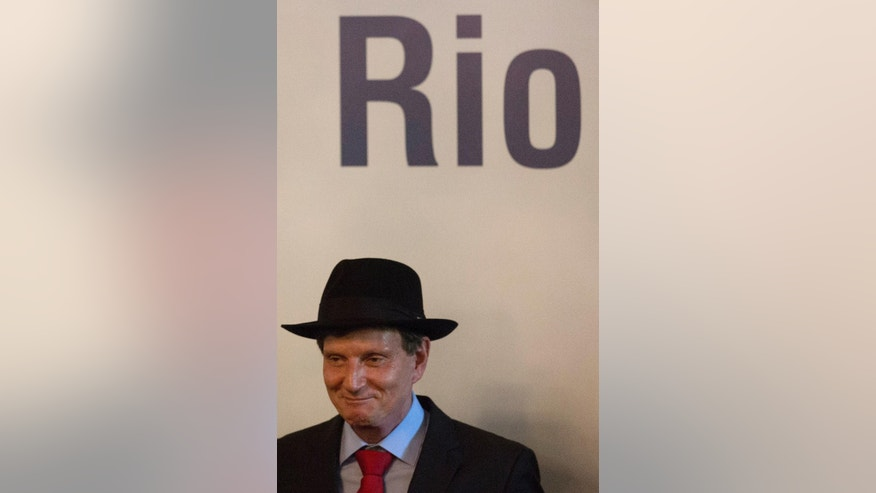 Evangelical bishop and senator Marcelo Crivella, bishop of the Universal Church of the Kingdom of God, wears a hat as he attends his inauguration ceremony as Rio de Janeiro's mayor, Sunday, Jan. 1, 2017. (AP Photo/Leo Correa)