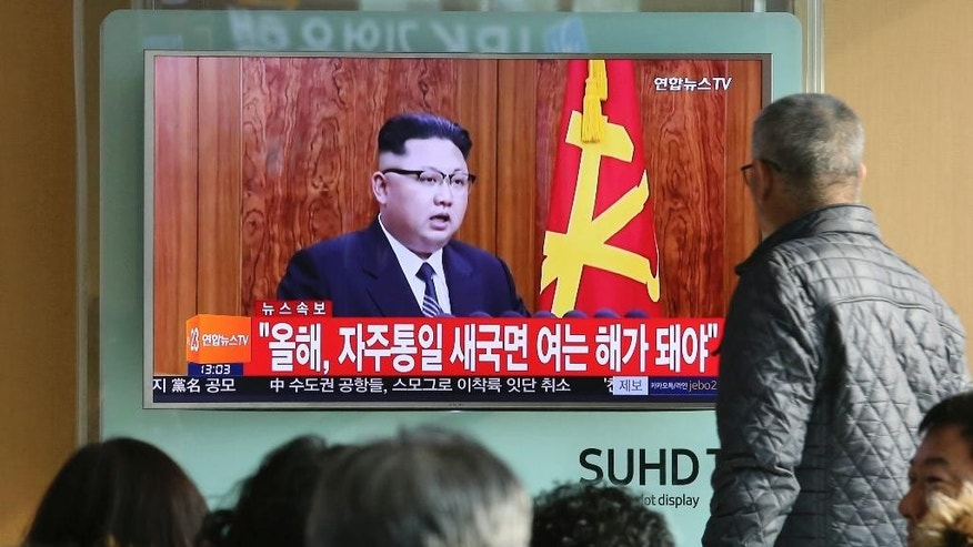 "South Koreans watch a TV news program showing North Korean leader Kim Jong Un's New Year's speech, at the Seoul Railway Station in Seoul, South Korea, Sunday, Jan. 1, 2017. North Korea's development of banned long-range missiles is in ""final stages,"" the country's leader Kim was quoted as saying in his New Year's message. The letters read ""New Year for Reunification."" (AP Photo/Ahn Young-joon)"