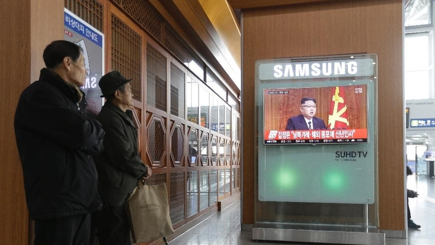 "South Koreans watch a TV news program showing North Korean leader Kim Jong Un's New Year speech, at the Seoul Railway Station in Seoul, South Korea, Sunday, Jan. 1, 2017. North Korea's development of banned long-range missiles is in ""final stages,"" the country's leader Kim was quoted as saying in his New Year's message. The letters read "" Kim Jong Un's New Year Speech "". (AP Photo/Ahn Young-joon)"