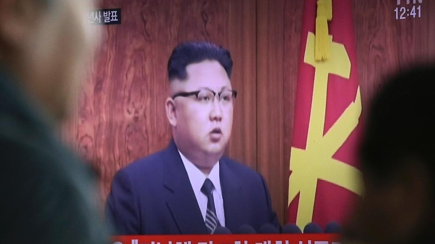 "North Korean leader Kim Jong Un delivering his New Year's speech appears on a TV news program shown at the Seoul Railway Station in Seoul, South Korea, Sunday, Jan. 1, 2017. North Korea's development of banned long-range missiles is in ""final stages,"" the country's leader Kim was quoted as saying in his New Year's message. (AP Photo/Ahn Young-joon)"