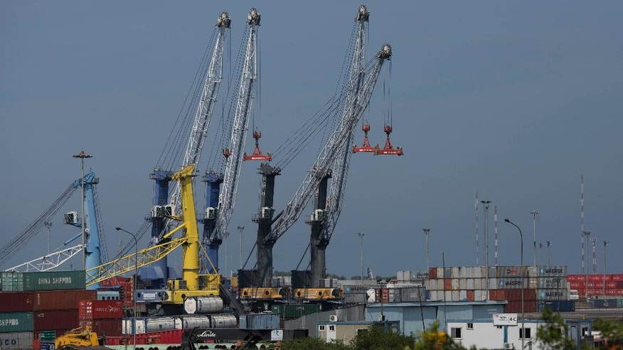In this Nov. 1, 2016 photo, cranes stand still high above containers at the port in Puerto Cabello, Venezuela. In 2014, 3,900 containers of government-imported goods were left abandoned at Puerto Cabello, the port that handles the majority of Venezuela's food imports, according to Gen. Hebert Garcia Plaza. (AP Photo/Ariana Cubillos)