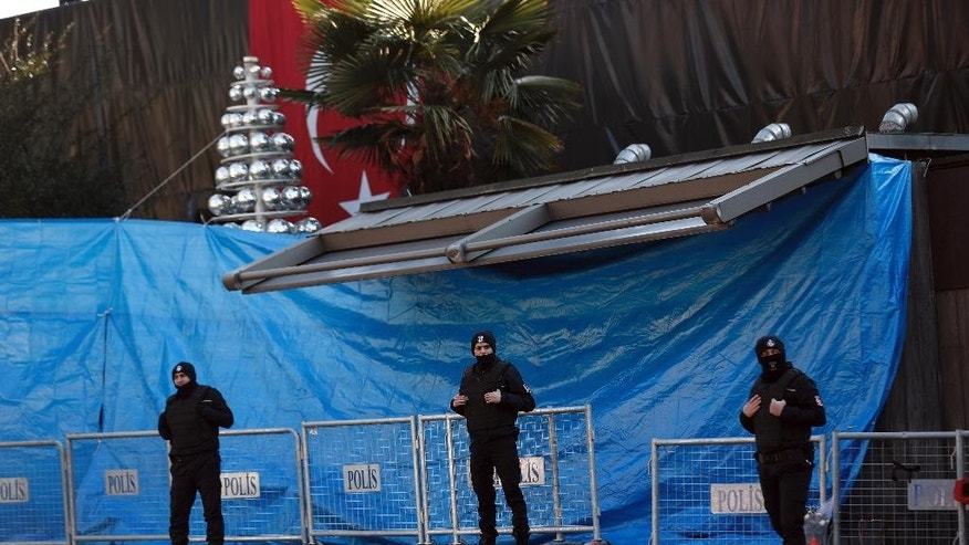 Turkish police officers stand guard outside the scene a day after an attack at a popular nightclub in Istanbul, Monday, Jan. 2, 2017.  A manhunt is on in Turkey as authorities work to identify the assailant who killed dozens of people in a crowded Istanbul nightclub during New Year's celebrations Sunday. (AP Photo/Halit Onur Sandal)
