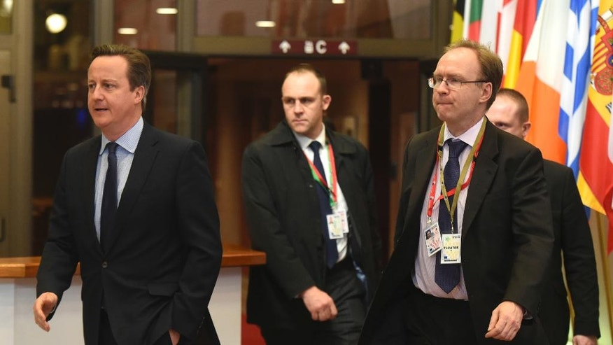 FILE - In this file photo dated  Friday, Feb. 19, 2016, British Prime Minister David Cameron, left, and Britain's permanent representative to European Union Ivan Rogers, right, leave after an EU summit in Brussels.  The British Foreign Office announced Tuesday Jan. 3, 2017, that Rogers has resigned, without giving any details about his departure.  (AP Photo/Geert Vanden Wijngaert, FILE)