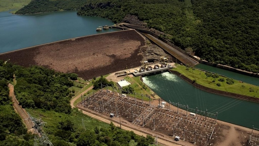 This 2008 photo released by Duke Energy shows an aerial view of the Chavantes Hydroelectric Plant, at Paranapanema river, Sao Paulo state, Brazil. Other investors are wary of Brazil, but when Duke Energy wanted to sell 10 hydroelectric dams there, a Chinese utility shrugged off the country's economic turmoil and paid $1.2 billion to add them to an energy empire that stretches from Malaysia to Germany to the Amazon. (Duke Energy via AP)