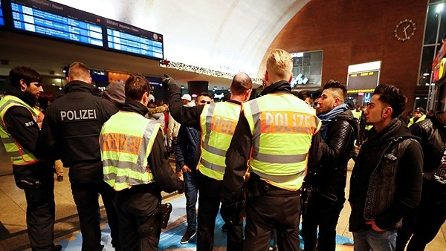 January 1, 2017: Police officers of Germany's federal police Bundespolizei check young men at the main railways station following New Year celebrations in Cologne, Germany.