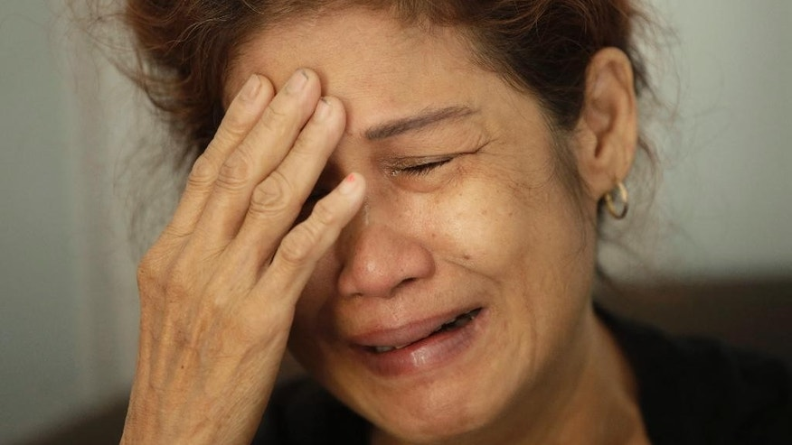 A family member weeps as she waits for the identification process of the victims of Sunday's ferry fire, at the main police hospital in Jakarta, Indonesia, Monday, Jan. 2, 2017. Zahro Express, a ferry carrying more than 200 Indonesians celebrating the New Year holiday caught fire off Jakarta Sunday killing more than 20 people and injuring dozens others. (AP Photo/Achmad Ibrahim)