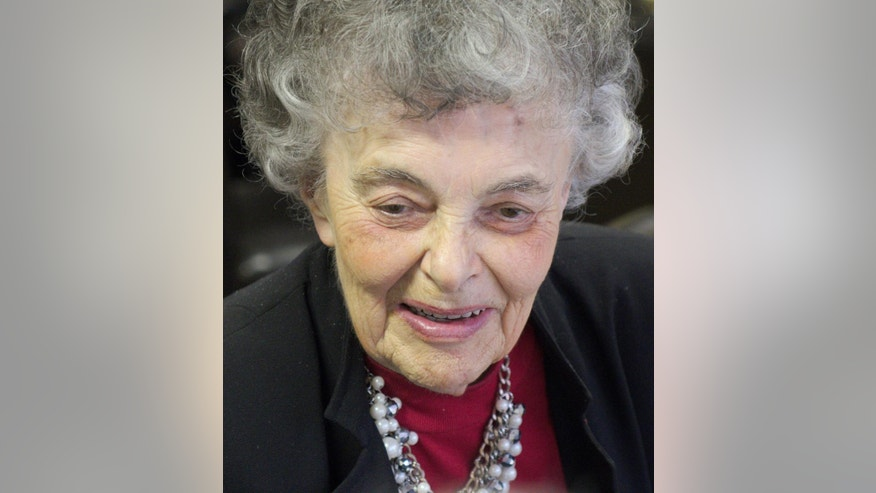 In this picture taken on, Wednesday, April. 8, 2015 in Prague, Czech Republic, former Associated Press correspondent Iva Drapalova smiles during her 90th birthday party. Drapalova who was based in Prague for two decades following the 1968 Soviet-led invasion of Czechoslovakia has died on Dec, 31, 2016, at age 91. (AP Photo/Antonin Novy)