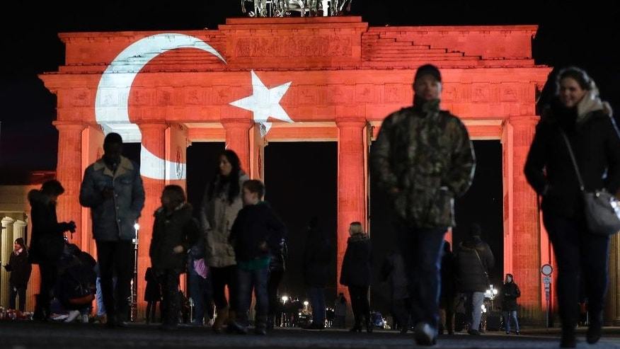 The Brandenburg Gate in Berlin, Germany, is illuminated in the colours of the flag of Turkey on Monday, Jan. 2, 2017 the day after an assailant killed dozens of people in a crowded Istanbul nightclub during New Year's celebrations on Sunday. (AP Photo/Michael Sohn)