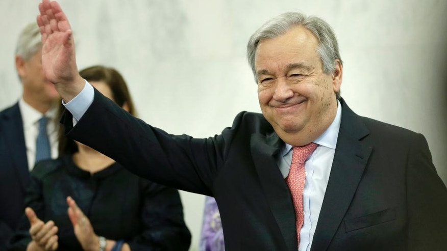 United Nations Secretary-General Antonio Guterres waves after talking with members of the U.N. staff at U.N. headquarters, Tuesday, Jan. 3, 2017. (AP Photo/Seth Wenig)