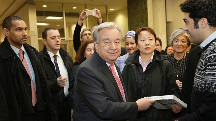 United Nations Secretary-General Antonio Guterres talks with people as he makes his way to a meeting with members of the U.N. staff at U.N. headquarters, Tuesday, Jan. 3, 2017. (AP Photo/Seth Wenig)