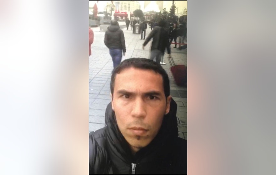 In this photo obtained Tuesday Jan. 3, 2017,  in this undated photo a man believed to be the gunman who killed dozens at an Istanbul nightclub, films himself and the street behind him as he wanders nearby Istanbul's crowded Taksim square.  An assailant armed with a long-barrelled weapon, opened fire at the nightclub in Istanbul's Ortakoy district during New Year's celebrations, killing dozens of people and wounding many others. No details have been released as to why the authorities might think the man in this selfie photo is a suspect in the New Year's attack. (DHA-Depo Photos via AP)
