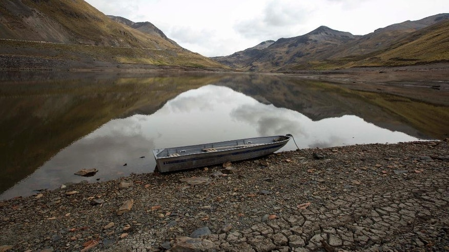 "In this Dec. 20, 2016 photo, a boat sits on the low bank of the Inca Chaca reservoir on the outskirts of La Paz, Bolivia. According to Dirk Hoffmann, a glacial and climate specialist, ""The 2015-2016 (El Nino) is one of the strongest in 30 years, although scientists' verdict on its role in the current drought has not been concluded yet."" (AP Photo/Juan Karita)"