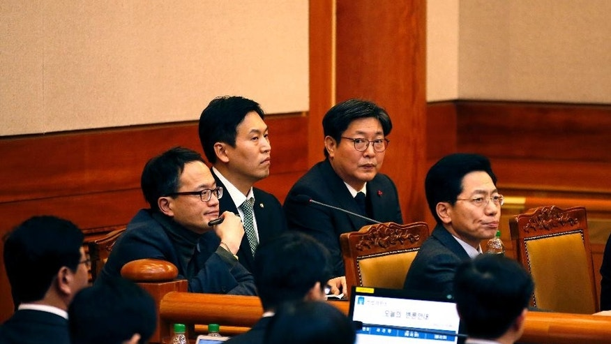 Lawyers for the parliament impeachment committee attend the first hearing arguments for South Korean President Park Geun-hye's impeachment trial at the Constitutional Court in Seoul, South Korea, Tuesday, Jan 3, 2017. (Kim Hong-Ji/Pool Photo via AP)