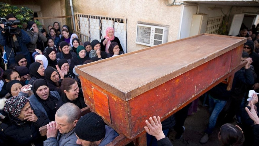 Israeli Arabs carry the coffin of Leanne Nasser, who was killed in the New Year's Eve attack in Istanbul, during her funeral, in the town of Tira, Israel, Tuesday, Jan. 3, 2017. Nasser, an 18-year-old Arab-Israeli from the town of Tira, was celebrating with friends when the gunman came in and opened fire. At least 39 people were killed and nearly 70 injured in the mass shooting that took place in front of and inside a popular Istanbul nightclub in the first hours of New Year's Day. The victims included citizens of Turkey, Saudi Arabia, Lebanon, Iraq, France, Tunisia, India, Morocco, Jordan, Kuwait, Canada, Israel, Syria, Belgium, Germany and Russia. (AP Photo/Ariel Schalit)