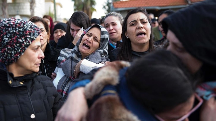 Lucy, mother of Leanne Nasser, center, mourns during the funeral of her daughter, who was killed in the New Year's Eve attack in Istanbul, in the town of Tira, Israel, Tuesday, Jan. 3, 2017. Nasser, an 18-year-old Arab-Israeli from the town of Tira, was celebrating with friends when the gunman came in and opened fire. At least 39 people were killed and nearly 70 injured in the mass shooting that took place in front of and inside a popular Istanbul nightclub in the first hours of New Year's Day. The victims included citizens of Turkey, Saudi Arabia, Lebanon, Iraq, France, Tunisia, India, Morocco, Jordan, Kuwait, Canada, Israel, Syria, Belgium, Germany and Russia. (AP Photo/Ariel Schalit)