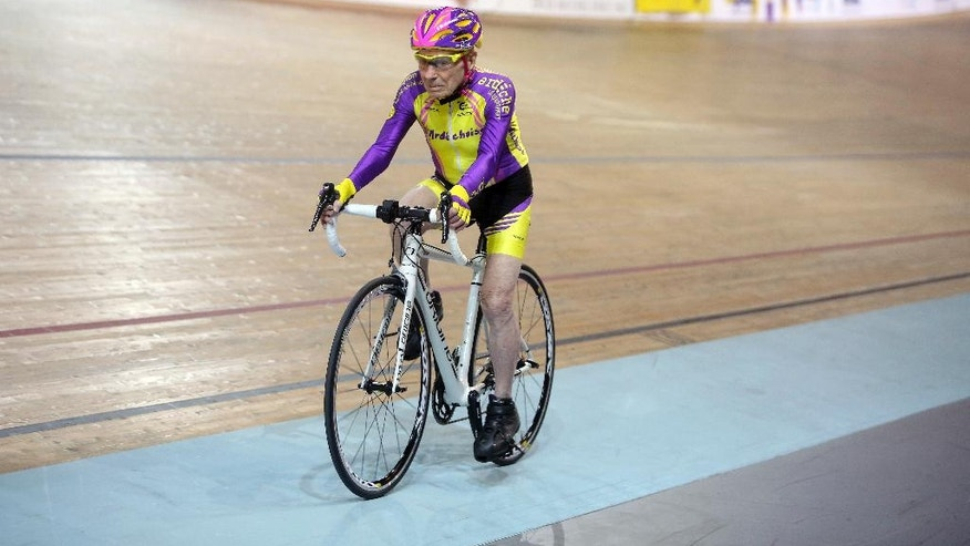 French cyclist Robert Marchand, 105, pedals in a bid to beat his record for distance cycled in one hour, at the velodrome of Saint-Quentin en Yvelines, outside Paris, Wednesday, Jan. 4, 2017. (AP Photo/Thibault Camus)