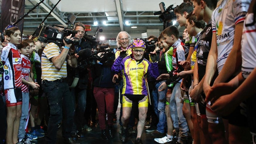 French cyclist Robert Marchand, aged 105, arrives prior to cycle in a bid to beat his record for distance cycled in one hour, at the velodrome of Saint-Quentin en Yvelines, outside Paris, Wednesday, Jan. 4, 2017. (AP Photo/Thibault Camus)