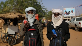 Two young Fulani men sell mobile phones in Niamey, Niger, February 19, 2016. REUTERS/Joe Penney - RTX27QLE