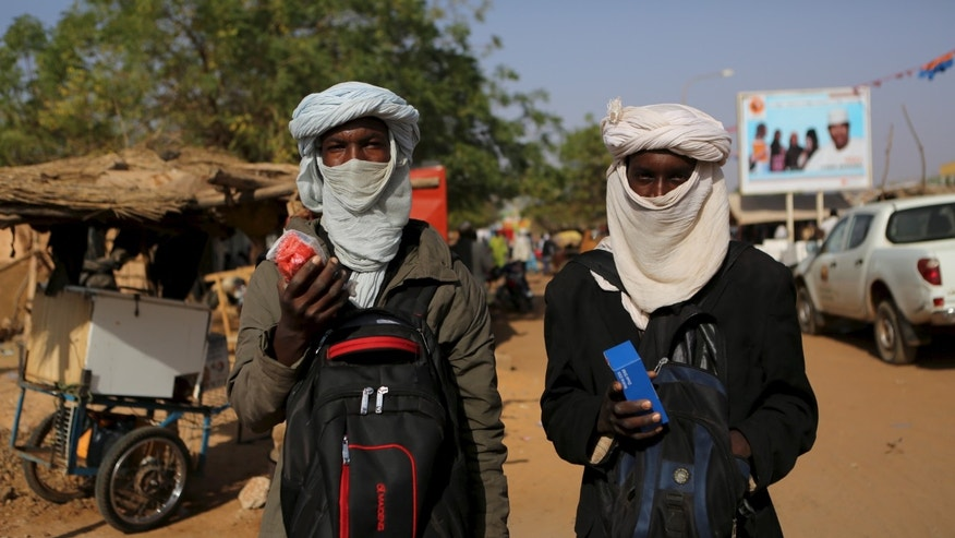 Two young Fulani men selling phones.