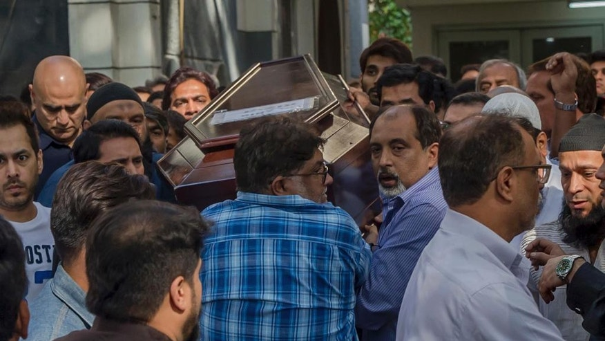 Friends and relatives carry the coffin of Abis Rizvi for his funeral, outside his house in Mumbai, India, Wednesday, Jan. 4, 2017. Rizvi was one of the two Indian victims of the New Year's attack at a popular Istanbul nightclub. The 49-year-old builder, wrote and produced the Bollywood movie in 2014 aimed at spreading awareness about tigers. (AP Photo/Rafiq Maqbool)