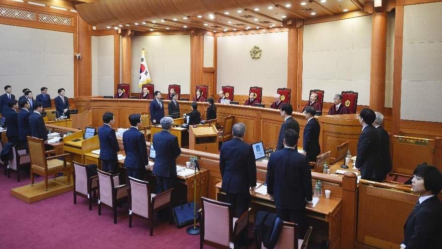 Nine judges of the Constitutional Court sit during a hearing on whether to confirm the impeachment of President Park Geun-Hye at the court Thursday, Jan. 5, 2017, in Seoul, South Korea. (Jung Yeon-Je/Pool Photo via AP)