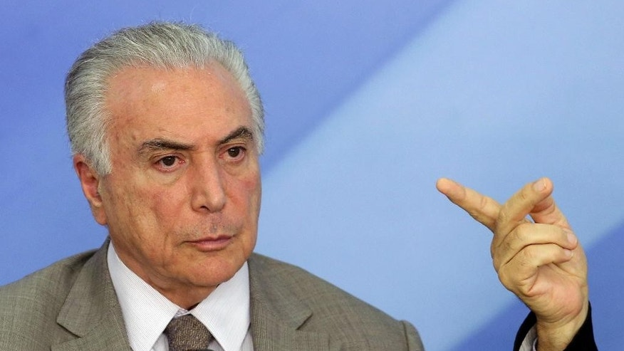 FILE - In this Dec. 15, 2016 file photo, Brazil's President Michel Temer attends a press conference on new measures to stimulate the economy, at Planalto presidential palace, in Brasilia, Brazil. Temer, a 75-year-old career politician who took over when President Dilma Rousseff was ousted last year, is facing myriad challenges that threaten his ability to remain in power. (AP Photo/Eraldo Peres, File)