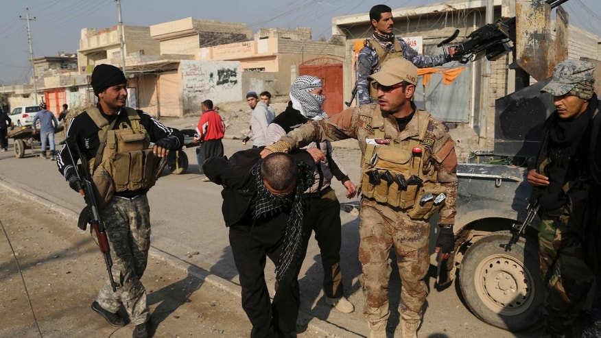 Iraqi security forces arrest a suspected fighter with the Islamic State group during a military operation to regain control of the eastern side of Mosul, Iraq, Wednesday, Jan. 4, 2017. (AP Photo/ Khalid Mohammed)