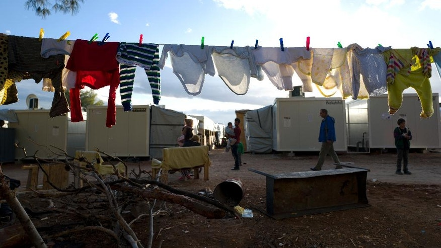 Washing is hung out to dry at the Ritsona refugee camp, about 86 kilometers (53 miles) north of Athens, Thursday, Jan. 5, 2017. Over 62,000 refugees and migrants are stranded in Greece after a series of Balkan border closures and an European Union deal with Turkey to stop migrant flows. (AP Photo/Muhammed Muheisen)