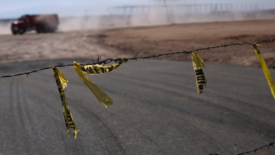 Barbed wire surrounds the site of a cancelled Ford auto manufacturing plant, one day after the U.S. auto company announced the project was called off, in Villa de Reyes, outside San Luis Potosi, Mexico, Wednesday, Jan. 4, 2017.  The perception in this region was largely that President-elect Donald Trump, who had promised for months to bring manufacturing jobs back to the U.S. while at the same time disparaging Mexicans, had made good before even settling into the White House. (AP Photo/Rebecca Blackwell)