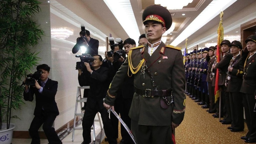 North Korean media take video footage and photos as Choe Ryong Hae, (unseen in photo) vice chairman of North Korea's State Affairs Commission, makes his way to the departure gates at the Pyongyang Airport after inspecting honor guards on Friday, Jan. 6, 2017, in Pyongyang, North Korea. Hae is heading to Nicaragua to attend the inauguration of their newly elected President Daniel Ortega. (AP Photo/Wong Maye-E)