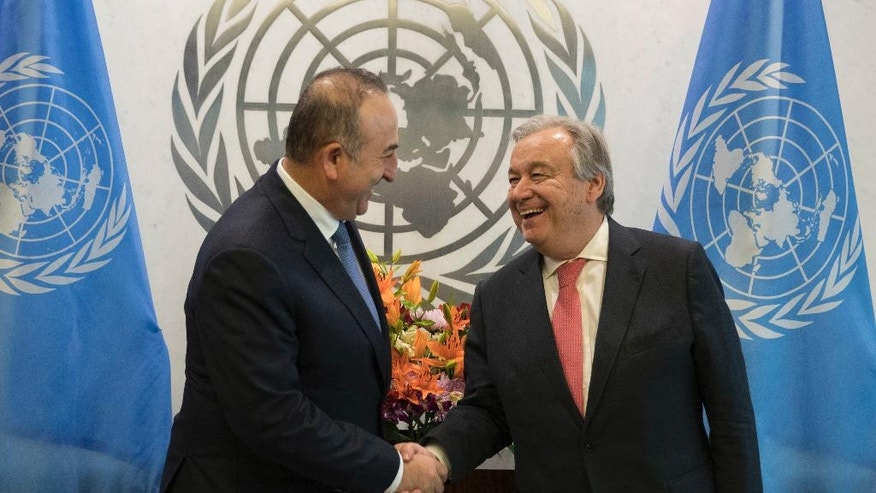 United Nations Secretary-General Antonio Guterres, right, meets with Turkey's Foreign Minister Mevlut Cavusoglu, Thursday, Jan. 5, 2017 at United Nations headquarters. (AP Photo/Mary Altaffer)